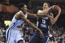 BYU's Brock Zylstra drives into the lane against Northern Arizona's Michael Dunn during an NCAA college basketball game in Prescott Valley, Ariz., on Wednesday, Nov. 30, 2011. BYU won 87-52. (AP Photo/The Daily Courier, Les Stukenberg) MANDATORY CREDIT