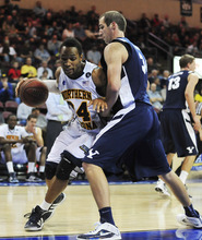 Northern Arizona's Darrell Norman drives the baseline against BYU's Noah Hartsock during an NCAA college basketball game in Prescott Valley, Ariz., on Wednesday, Nov. 30, 2011. BYU won 87-52. (AP Photo/The Daily Courier, Les Stukenberg) MANDATORY CREDIT