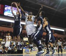 BYU's Brock Zylstra (13) grabs a rebound from Northern Arizona's Ephraim Ekanem (42) during an NCAA college basketball game Wednesday, Nov. 30, 2011, in Prescott Valley, Ariz. BYU won 87-52. (AP Photo/The Daily Courier, Les Stukenberg) MANDATORY CREDIT