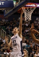Rick Egan  | The Salt Lake Tribune   BYU's Stephen Rogers (21) scores for the Cougars, in second half basketball action, BYU vs Oregon, at EnergySolutions Arena, Saturday, December 3, 2011.
