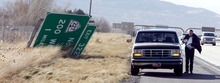 Steve Griffin  |  The Salt Lake Tribune A motorist stops on I-15 to secure cargo in his truck bed as high winds whip through Centerville on Thursday.