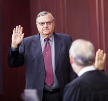 Presiding Disciplinary Judge William O'Neil, right, swears in Maricopa County Sheriff Joe Arpaio during the State Bar of Arizona's ongoing disciplinary hearings against former Maricopa County attorney Andrew Thomas and two assistants, at the Arizona Supreme Court in Phoenix Tuesday, Oct. 18, 2011.  (AP Photo/Jack Kurtz, Pool)