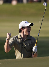 Northern Ireland's Rory McIlroy celebrates after a birdy at the 18th hole, winning in the Hong Kong Open golf tournament in Hong Kong Sunday, Dec. 4, 2011. (AP Photo/Vincent Yu)