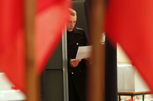 A naval sailor prepares to cast his ballot at a poling station during parliamentary election in St. Petersburg, Russia, Sunday, Dec. 4, 2011. (AP Photo/Dmitry Lovetsky)