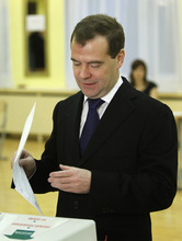 Russian President Dmitry Medvedev casts his ballot at a polling station in Moscow,  Russia, Sunday, Dec. 4, 2011. Russians cast their ballots with muted enthusiasm in national parliament elections on Sunday, a vote that opinion polls indicate could water down the strength of the country's dominant party. (AP Photo/Misha Japaridze, Pool)