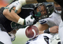 Eugene Tanner  |  The Associated Press Hawaii running back Joey Iosefa fumbles the football which is recovered by BYU and run in for a touchdown in the third quarter of an NCAA college football game Saturday in Honolulu.
