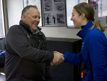 Al Hartmann  |  The Salt Lake Tribune  Steven Gilman, left, shakes hands with Merebea Danforth after winning a coin toss that determined the winner for seat on the Alta Town Council on Monday December 5. They each received 60 votes each in the last election. Monday's coin toss broke the tie with the seat going to Gilman.