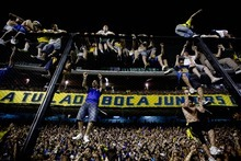 Boca Juniors' soccer fans celebrate winning Argentina's soccer league championship title after defeating Banfield 3-0 in Buenos Aires, Argentina, Sunday Dec. 4, 2011. (AP Photo/Natacha Pisarenko)