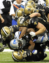 Detroit Lions wide receiver Stefan Logan (11) is stopped by the New Orleans Saints defense during the first quarter of an NFL football game in New Orleans, Sunday, Dec. 4, 2011. (AP Photo/Bill Feig)