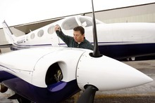 TRENT NELSON | Tribune File Photo Rep. Stephen Sandstrom in a newly filed financial disclosure reports a net worth -- including the value of his business -- at some $11 million. In this file photo, taken last January, he does a pre-flight inspection of his airplane (a Cessna 340) at the Spanish Fork-Springville Airport.