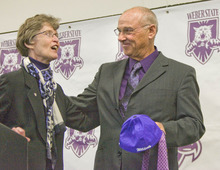 Paul Fraughton | The Salt Lake Tribune Weber State University President, Ann Milner  provides John L. Smith with a few purple Weber State ties and a hat as he is introduced at a press conference as Weber State's new head football coach.   Tuesday, December 6, 2011