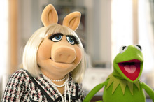 In this undated photo provided by Disney Enterprises, Kermit the Frog, right, tries to persuade Miss Piggy to help save the Muppet Theater from being torn down in a scene from