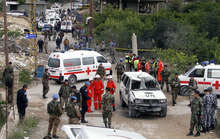 United Nations and emergency personnel gather at the site of a roadside bomb attack on a U.N. peacekeepers' vehicle in Bourj al-Shamali, near the port city of Tyre, Lebanon, Friday, Dec. 9, 2011. A roadside bomb struck a vehicle carrying United Nations peacekeepers in southern Lebanon on Friday, wounding five French soldiers and a Lebanese bystander, officials said. This was the third bombing this year targeting the international force known as UNIFIL, which is deployed to keep the peace along Lebanon's southern border with Israel. (AP Photo/Mohammed Zaatari)