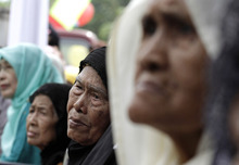 Surviving widows and relatives of men killed in a notorious massacre  gather for commemoration in Rawagede, West Java, Indonesia, Friday, Dec. 9, 2011. After six decades of waiting, relatives of men killed in a notorious massacre during Indonesia's bitter struggle for independence finally got what they wanted: An official apology from the Dutch state.(AP Photo/Achmad Ibrahim)