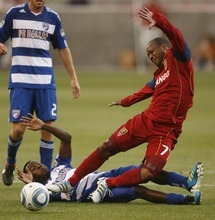 Trent Nelson  |  The Salt Lake Tribune RSL's Andy Williams is tripped up by FC Dallas's Marvin Chavez. during a match against FC Dallas at Rio Tinto Stadium in Sandy on July 9, 2011.