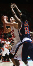 Kim Raff | The Salt Lake Tribune Utah center Jason Washburn works on creating room while being defended by Cal State-Fullerton's Orane Chin at the Huntsman Center on Wednesday.