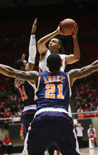 Kim Raff | The Salt Lake Tribune Utah's Dijon Farr goes up for a shot while being defended by Cal State-Fullerton's D.J. Seeley, left, and Omondi Amoke at the Huntsman Center on Wednesday.