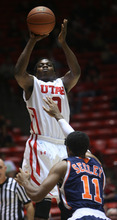 Kim Raff | The Salt Lake Tribune Utah's Anthony Odunsi goes up for a jump shot while being defended by Cal State-Fullerton's D.J. Seeley at the Huntsman Center on Wednesday.
