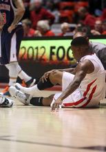 Kim Raff | The Salt Lake Tribune Utah's Kareem Storey nurses an injury during the second half against Cal-State Fullerton at the Huntsman Center on Wednesday.