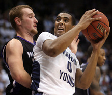 Steve Griffin  |  The Salt Lake Tribune BYU's Brandon Davies turns into Weber State's Kyle Tresnak during first-half action versus Weber State at the Marriott Center in Provo on Wednesday, December 7, 2011.