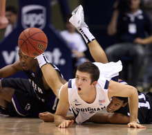 Steve Griffin  |  The Salt Lake Tribune  Weber State's Jordan Richardson, left, and Gelaun Wheelwright dive to the floor as they battle BYU's Craig Cusick for the ball during first-half action versus Weber State at the Marriott Center in Provo on Wednesday, December 7, 2011.