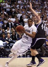 Steve Griffin  |  The Salt Lake Tribune  BYU's Brandon Davies drives around Weber State's Kyle Tresnak during first-half action versus Weber State at the Marriott Center in Provo on Wednesday, December 7, 2011.