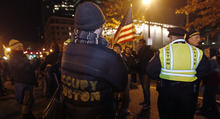 Boston police officers removed Occupy Boston protesters from Dewey Square in Boston before dawn Saturday, Dec. 10, 2011. More than 40 people were peacefully arrested as the park was cleared. (AP Photo/The Boston Globe, Essdras M Suarez, , Pool)