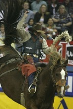 Rick Egan  | The Salt Lake Tribune   Cody Wright, Milford, rides in the saddle bronc competition, at the National Finals Rodeo, in Las Vegas, Thursday, December 8, 2011.