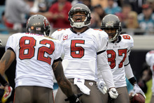 Tampa Bay Buccaneers quarterback Josh Freeman (5) celebrates his 13-yard touchdown run with teammates Kellen Winslow (82) and Preston Parker (87) during the first half of an NFL football game against the Jacksonville Jaguars, Sunday, Dec. 11, 2011, in Jacksonville, Fla. (AP Photo/Phelan M. Ebenhack)