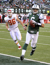 New York Jets' Mark Sanchez, right, runs the ball into the end zone while Kansas City Chiefs' Andy Studebaker follows during the first quarter of the NFL football game Sunday, Dec. 11, 2011, in East Rutherford, N.J. (AP Photo/Bill Kostroun)