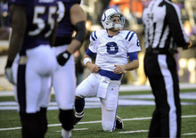 Indianapolis Colts quarterback Dan Orlovsky stands up after being tackled in the first half of an NFL football game against the Baltimore Ravens in Baltimore, Sunday, Dec. 11, 2011. (AP Photo/Nick Wass)