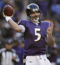Baltimore Ravens quarterback Joe Flacco throws to a receiver in the first half of an NFL football game against the Indianapolis Colts in Baltimore, Sunday, Dec. 11, 2011. (AP Photo/Patrick Semansky)