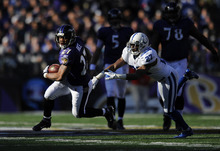 Baltimore Ravens running back Ray Rice, left, rushes past Indianapolis Colts cornerback Jacob Lacey in the first half of an NFL football game in Baltimore, Sunday, Dec. 11, 2011. (AP Photo/Nick Wass)