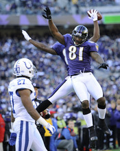 Baltimore Ravens wide receiver Anquan Boldin (81) celebrates with Baltimore Ravens wide receiver Torrey Smith, behind, after Smith's touchdown in front of Indianapolis Colts cornerback Jacob Lacey in the first half of an NFL football game in Baltimore, Sunday, Dec. 11, 2011. (AP Photo/Nick Wass)