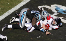 Carolina Panthers' Antwan Applewhite (93) sacks Atlanta Falcons' Matt Ryan (2) for a safety during the second quarter of an NFL football game in Charlotte, N.C., Sunday, Dec. 11, 2011. (AP Photo/Nell Redmond)
