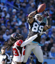 Carolina Panthers' Steve Smith (89) catches a pass as Atlanta Falcons' Dunta Robinson (23) defends during the first quarter of an NFL football game in Charlotte, N.C., Sunday, Dec. 11, 2011. (AP Photo/Bob Leverone)