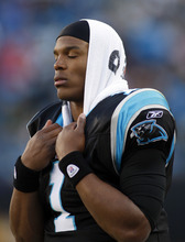 Carolina Panthers' Cam Newton (1) stands on the sidelines after throwing an interception during the third quarter of an NFL football game against the Atlanta Falcons in Charlotte, N.C., Sunday, Dec. 11, 2011. (AP Photo/Nell Redmond)