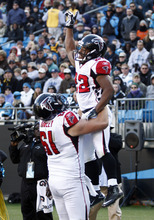 Atlanta Falcons' Jacquizz Rodgers (22) celebrates his touchdown catch against the Carolina Panthers with teammate Joe Hawley (61) during the third quarter of an NFL football game in Charlotte, N.C., Sunday, Dec. 11, 2011. (AP Photo/Nell Redmond)
