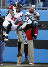 Carolina Panthers' Darius Butler (27) breaks up a pass intended for Atlanta Falcons' Julio Jones (11) during the third quarter of an NFL football game in Charlotte, N.C., Sunday, Dec. 11, 2011. (AP Photo/Bob Leverone)
