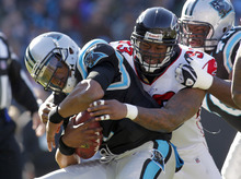 Carolina Panthers' Cam Newton, left, is sacked by Atlanta Falcons' Ray Edwards, right, during the first quarter of an NFL football game in Charlotte, N.C., Sunday, Dec. 11, 2011. (AP Photo/Bob Leverone)