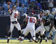 Atlanta Falcons' Matt Ryan (2) throws a pass against the Carolina Panthers during the second quarter of an NFL football game in Charlotte, N.C., Sunday, Dec. 11, 2011. (AP Photo/Chuck Burton)