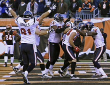 Houston Texans wide receiver Kevin Walter (83) is mobbed by teammates after catching a touchdown pass in the closing seconds of an NFL football game against the Cincinnati Bengals, Sunday, Dec. 11, 2011, in Cincinnati. Houston won 20-19. (AP Photo/Al Behrman)