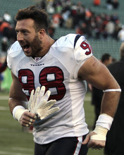Houston Texans linebacker Connor Barwin runs off the field after Houston defeated Cincinnati Bengals 20-19 in an NFL football game on Sunday, Dec. 11, 2011, in Cincinnati. (AP Photo/Tony Tribble)