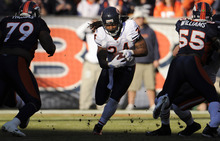 Chicago Bears running back Marion Barber rushes through a hole between Denver Broncos' Marcus Thomas (79) and D.J. Williams (55) during an NFL football game, Sunday, Dec. 11, 2011, in Denver. (AP Photo/The Denver Post, Joe Amon)  MANDATORY CREDIT; MAGS OUT; TV OUT