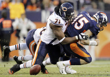 Chicago Bears defensive end Israel Idonije (71) hits Denver Broncos quarterback Tim Tebow (15) causing him to fumble the ball in the fourth quarter of an NFL football game, Sunday, Dec. 11, 2011, in Denver. Idonije recovered the fumble on the play. (AP Photo/Joe Mahoney)