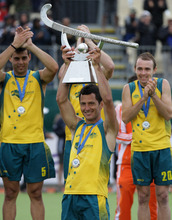Australia's Jamie Dwyer raises the trophy after defeating Netherlands in the gold medal match of the Hockey Champions Trophy in Auckland, New Zealand, Sunday, Dec. 11, 2011. (AP Photo/SNPA, David Rowland) NEW ZEALAND OUT
