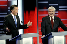 Republican presidential candidates former Massachusetts Gov. Mitt Romney, left, and former Speaker of the House Newt Gingrich, right, during  the Republican debate, Saturday, Dec. 10, 2011, in Des Moines, Iowa.  Attacked as a lifelong Washington insider,  Gingrich parried criticism from Mitt Romney Saturday night, telling the former Massachusetts governor,