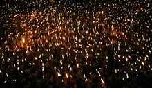 Participants hold torches in an attempt to break a world record of the most torches lit at a square in Jakarta, Indonesia, on Saturday Dec. 10, 2011. Organizers claimed 3,777 participants from the Freedom Faithnet Global (FFG) community joined to break the world record. (AP Photo/Achmad Ibrahim)