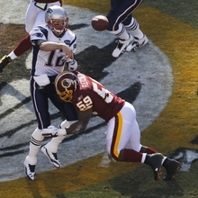 New England Patriots quarterback Tom Brady (12) passes the ball before being hit by Washington Redskins inside linebacker London Fletcher (59), during the first half of an NFL football game on Sunday, Dec., 11, 2011, in Landover, Md. (AP Photo/Pablo Martinez Monsivais)
