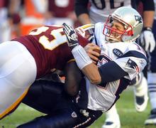 New England Patriots quarterback Tom Brady (12) is hit by Washington Redskins inside linebacker London Fletcher (59) during the first half of an NFL football game on Sunday, Dec., 11, 2011, in Landover, Md. (AP Photo/Rich Lipski)